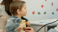 Hospital: Doctor Checks Heartbeat Of Young Boy video
