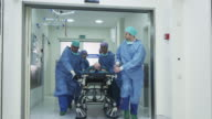 Hospital Emergency Team Carrying Stretcher with Patient through Hospital Hall video