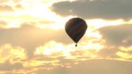 hot air balloon flying at sunrise video