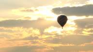 hot air balloon flying at sunrise video