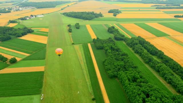 AERIAL Hot air balloon in a rural countryside video