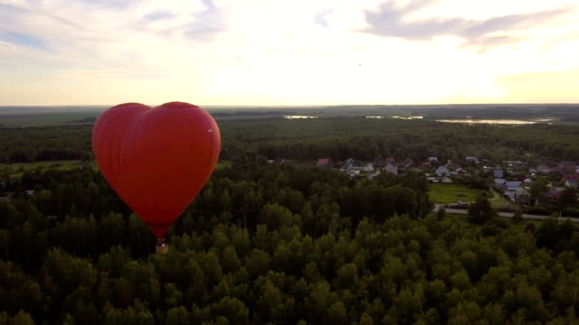 Hot air balloon in the sky over a field.Aerial view video