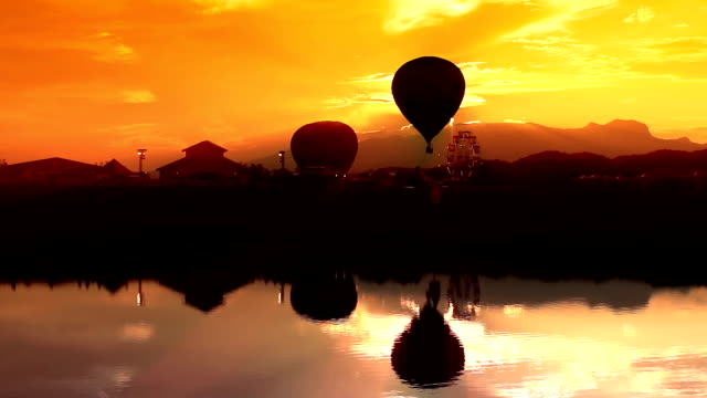 Hot Air Balloon Silhouette with water reflection video