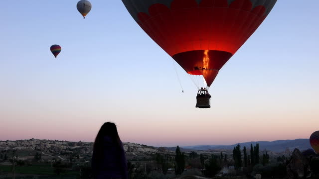 hot air balloons in the air  from within the valley in Cappadocia video