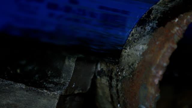 Hot blade cutting rusty metal video