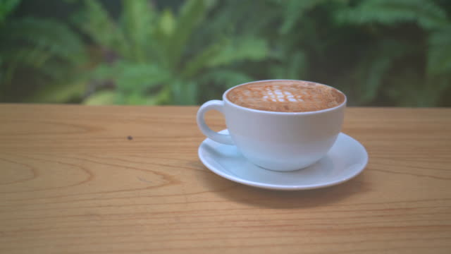 hot caramel macchiato on wood table video