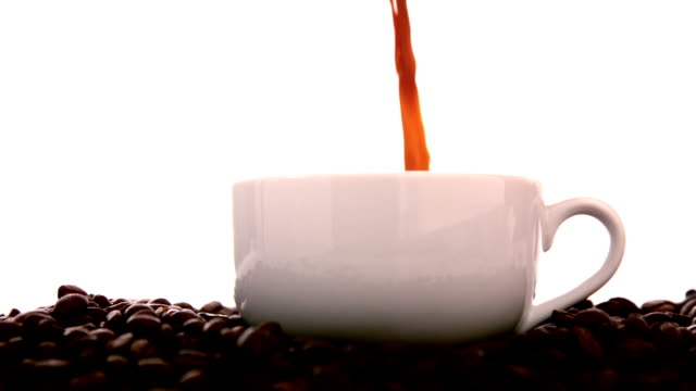 Hot coffee pouring into white cup video