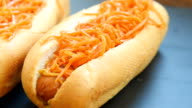 Hot dog with mustard and carrot video