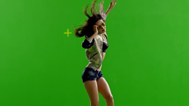 FEW SHOTS! Hot girl dancing. Slow motion. With real strobe lights on body. Green screen. Chroma key. Shot on RED EPIC Cinema Camera. video
