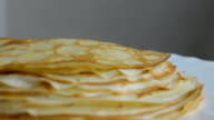 hot just backed pancakes on a plate video