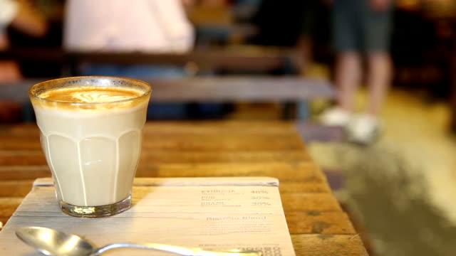 Hot latte art coffe on wood table video