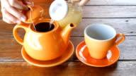 Hot Lemon Tea Pouring From Ceramic Pot video