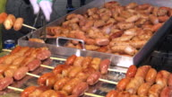 Hot sausage grilled ,Myeongdong street food , Seoul , South Korea. video