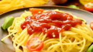 Hot spaghetti with ketchup and fresh tomatoes video