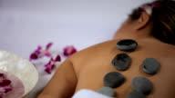 Hot stone spa treatment, closeup video