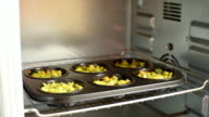 Hot tasty muffins with broccoli for dinner. Cooking concept video
