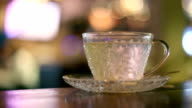 Hot water in tea glass cup video
