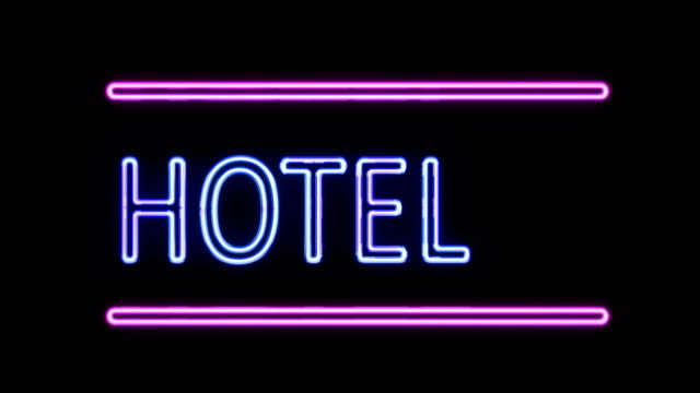 Hotel and Arrow Neon Sign in Retro Style Turning On video