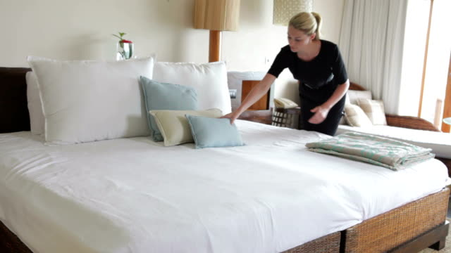 Hotel Chambermaid Making Guest Bed video