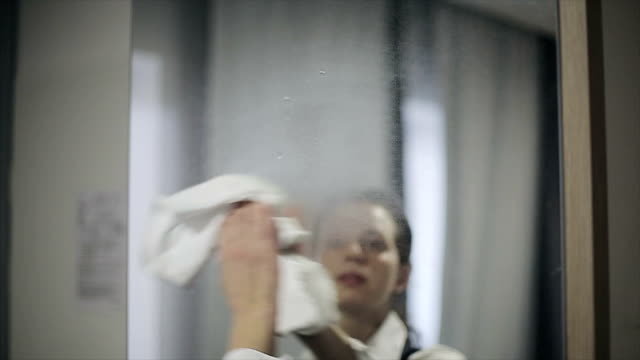 Hotel: Maid cleans the room at the hotel. Slow motion video