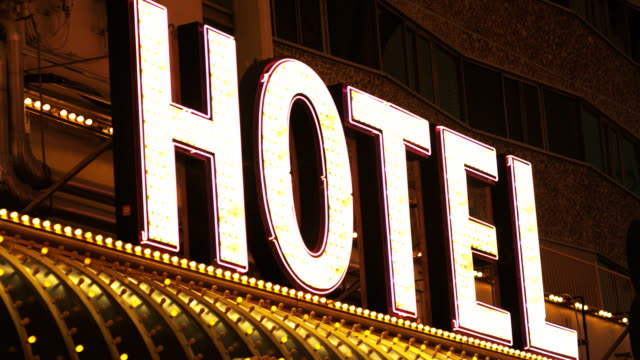 Hotel sign at night video