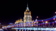 Hotel Ukraine winter night timelapse hyperlapse with bridge over Moscow River video