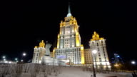 Hotel Ukraine winter night timelapse hyperlapse with Shevchenko monument on Moscow River video