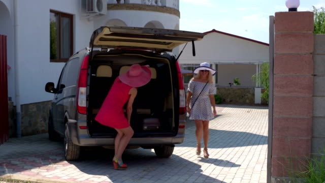 Hotel van shuttle service passengers with luggage arrived at resort on vacation video