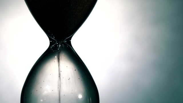 Hourglass on a White Background, the sand Falls Inside video