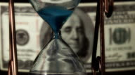 hourglass on the background of dollar bills video