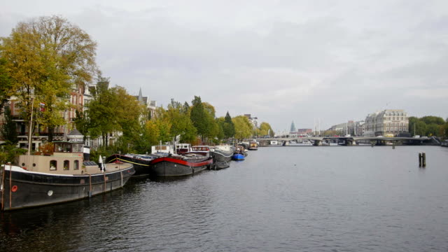 House boat on canal in Amsterdam, Amstel, Holland, Netherlands video