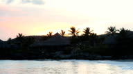 House by the sea at sunset video