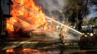 House fire, falling debris, and Firefighters video