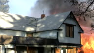 House fire with debris flying video