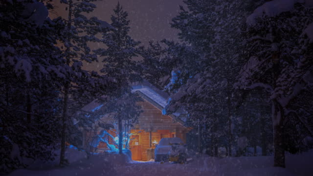 House in the Forest at Night and Snowfall. UHD video