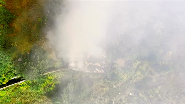 House is on fire - Firefighters extinguish a fire with water. Aerial video