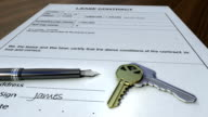 House keys and pen on a signed contract. video