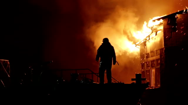 House on fire. Conflagration. Fireman fights fire. video