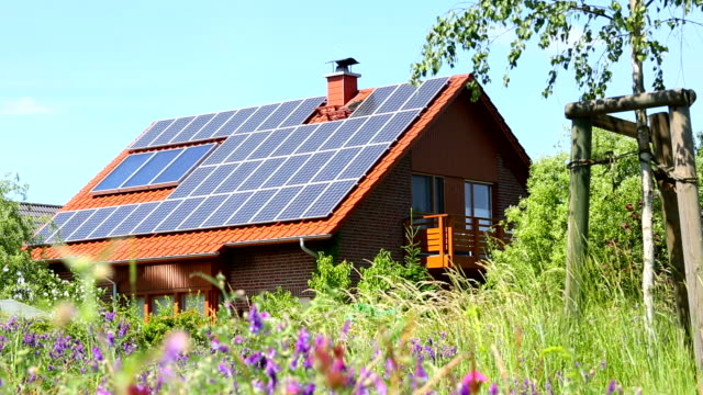 House with solar panels video