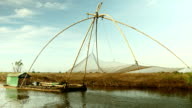 Chinese fishing net on a river video
