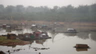 Houseboats and chinese fishing nets in early morning fog video