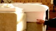 housemaid covers a bed video