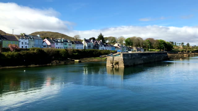 Houses behind the harbor wall in Ireland, UK video