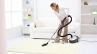 Housewife cleaning the room with vacuum cleaner. video