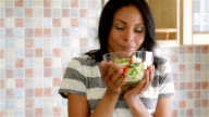 Housewife in kitchen with salad video