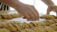 housewife lines up homemade cookies on a cloth video