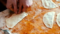 Housewife roasts chebureks in pan - Georgian national dish video