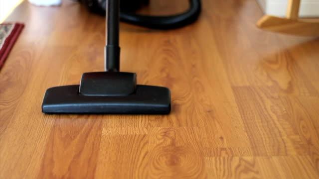 Housewife Vacuuming Laminate Floor video