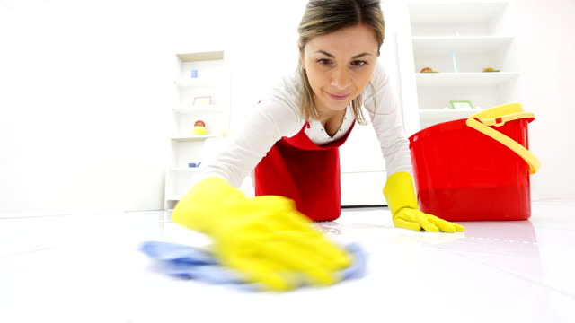 Housewife washing floors with a rag. video