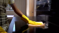 Housewife Wipes The Surface Of The Electric Stove With A Special Cleaning Cloth. video